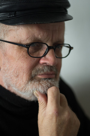 Portrait of a thoughtfull man with eye glasses and beard