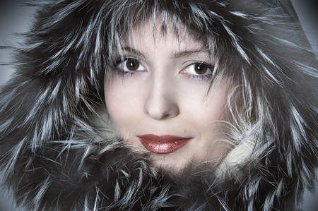 Fashion woman in fur smiling. Fashionable portrait of happy girl. photo