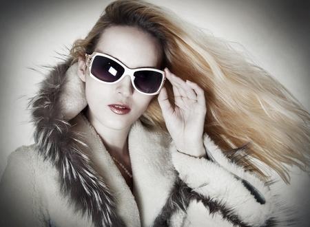 sheepskin: Fashion portrait of seductive glamour woman in designer sunglasses Stock Photo