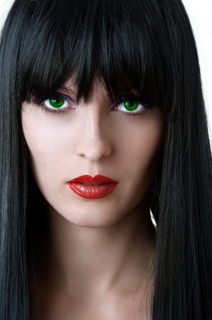 Fashion portrait of glamour woman with green eyes black hair and seductive red lips closeup