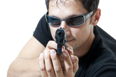 Criminal theme - man in sunglasses with gun, isolated on white  photo