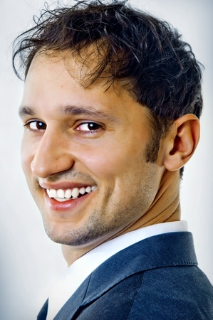 Close-up portrait of a happy handsome young man in a business suit Stock Photo - 8928959