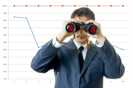 business man with binoculars looking to the income.  there are dollars on the reflections of the lenses. there are column graphs on background photo