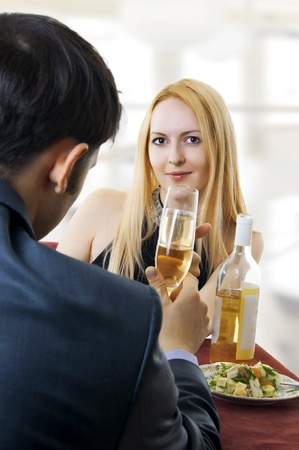 Young adult seductive couple at restaurant dining and toasting. Stock Photo - 9064480