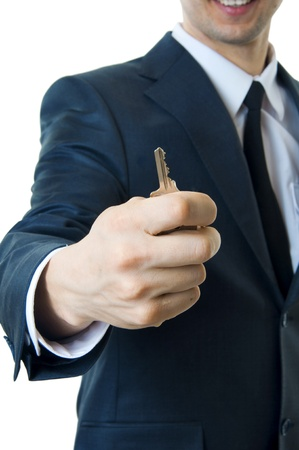 Man with key closeup. Focus on hand with key only. Stock Photo - 9117288