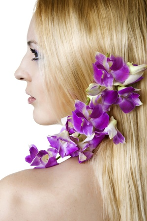 saxy: beauty flower girl in profile on the white background. Violet orchid