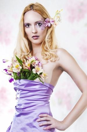 georgeous: Fashion portrait of beautiful woman with spring flowers and creative makeup