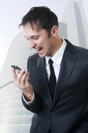 Angry business man shouting on the phone outdoor Stock Photo - 9257235