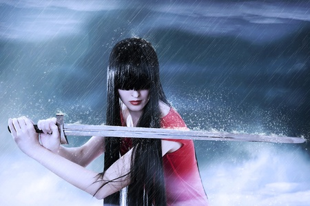 Fashion fantasy portrait of young pretty brunette woman fighter with sword in mist Stock Photo - 9276883
