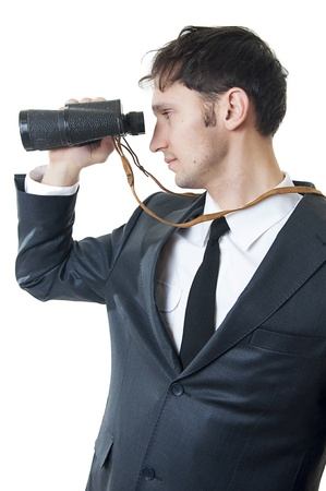 Portrait of a successful young business man looking through binoculars isolated on white background Stock Photo - 9276880