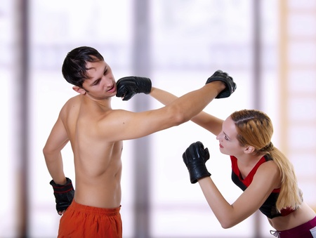 Fight of young coupe. Mixed martial art photo