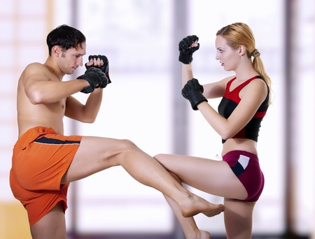 mixed marriage: Fight of young coupe. Mixed martial art Stock Photo