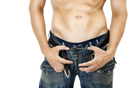 Sexy Muskular man stomach. Dark blue jeans photo