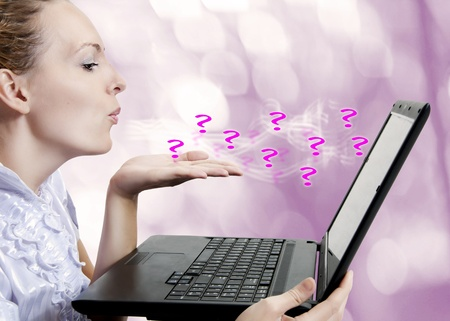 Concept - young attractive woman with laptop computer asking questions on forum, chat or blog Stock Photo