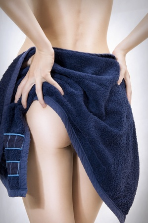 attractive ass: Sexual female body. Woman taking a dark blue towel