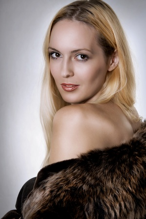 Fashion studio portrait of beautiful woman in fur coat closeup Stock Photo - 10171077