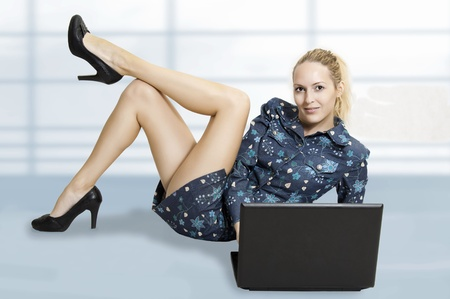 business woman legs: Portrait of cute sexy woman with laptop computer