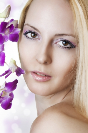 Beauty portrait of cute woman with summer or spring flowers and make up Stock Photo - 10233158