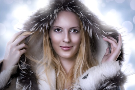 Fashion portrait of beautiful cute woman in fur coat photo
