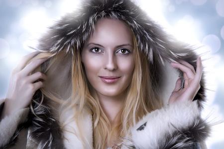 Fashion portrait of beautiful cute woman in fur coat Stock Photo - 10260138