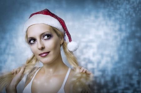 Fashion portrait of beautiful smile woman in santa hat. Christmas concept Stock Photo - 10378682