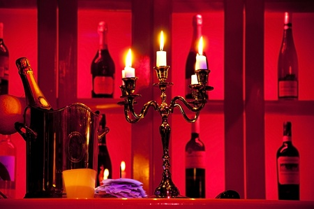 Five candels with flame in candelstick in bar