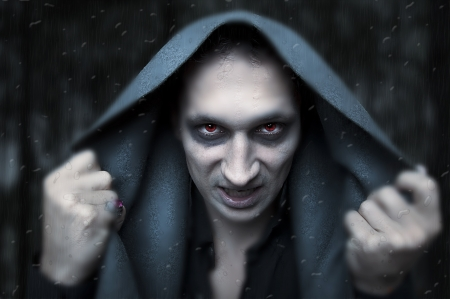 Portrait horrible fashion male vampire demon or evil wizard Stock Photo - 10394635