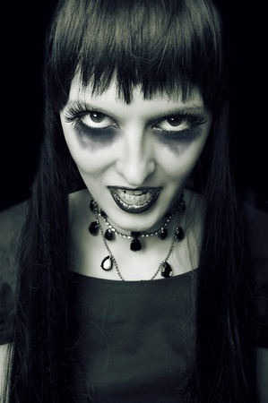 Halloween. Fashion portrait of night vampire gothic style woman. Zombie or witch photo