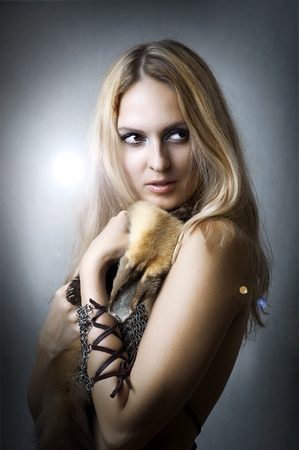 studio portrait of young adult beautiful sexy female model with fox fur Stock Photo - 10442419