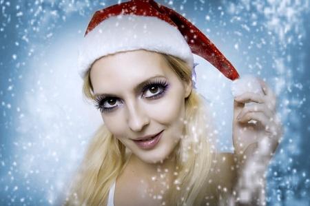 Christmas bright make-up concept. Portrait of young woman model at santa hat, face closeup Stock Photo - 10465923