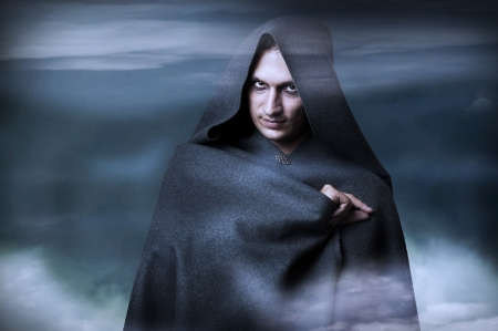 monk: Halloween concept. Fashion portrait of Male witch, wizard or monk in capote Stock Photo