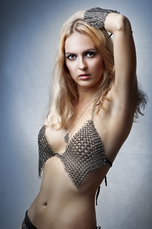 adult armpit: Glamour portrait of beauty fashion woman in chain armour Stock Photo