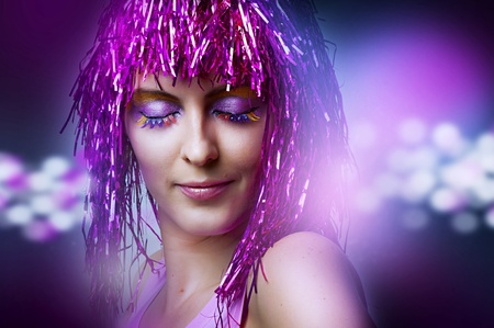 Fashion portrait of female model with bright glamour makeup dancing on 80s style night party photo