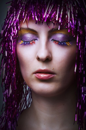 Bright glamour make-up for party or celebration. Fashion  portrait of female model face closeup. carnival wearing glossy pink wig Stock Photo - 10543877