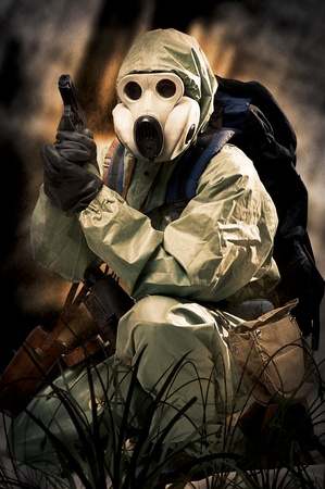Post apocalypses world halloween concept. Portrait of man in gas mask  photo