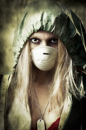 end of the world: Post apocalypses world halloween concept. Portrait of young Sad woman in breathing mask