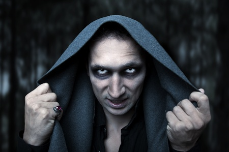 Portrait horrible fashion male vampire (demon or evil wizard)  Halloween concept. Mystery white eyes photo