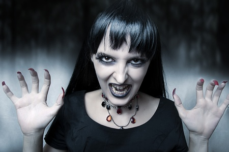 dracula woman: Horror and halloween concept. Fashion portrait of female vampire at the night. Gothic style woman Stock Photo