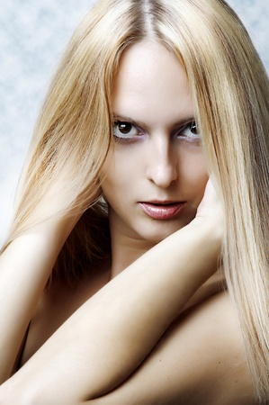 Fashion portrait of glamour smiling woman model with natural make-up and health long blonde straight hair Stock Photo - 10573403