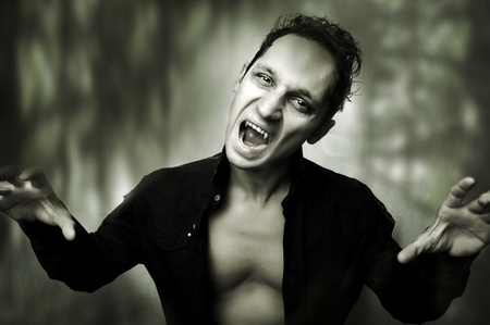 Halloween horror concept. Dark portrait of Night mystic male vampire Stock Photo - 10623753