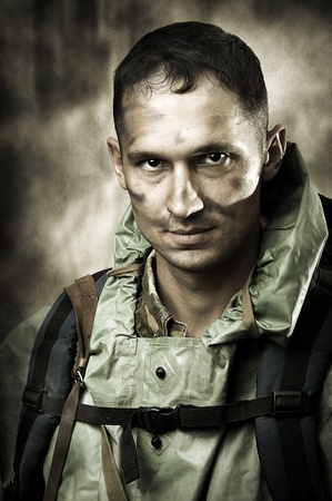 post apocalypse: Post apocalypses world halloween concept. Portrait of young Sad handsome military man soldier