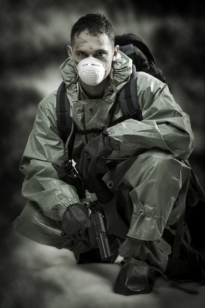 Post apocalypses world halloween concept. Portrair of man in gas mask  photo