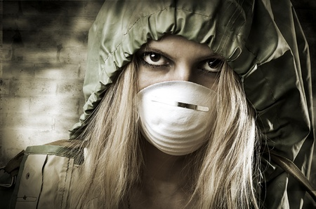 female soldier: Post apocalypses world halloween concept. Portrait of young Sad woman in breathing mask