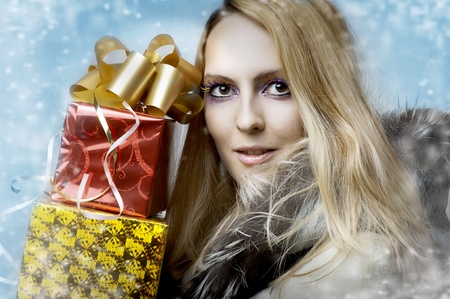 Christmas concept. Beauty portrait happy woman model holding two gift boxes in hands and smile  photo