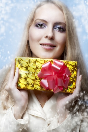 santa girl: Christmas concept. Beauty portrait happy woman model holding gift in hands and smile