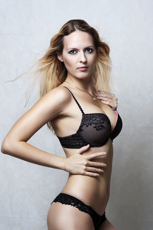 Fashion portrait of sexy fit underwear model. Young woman wearing black lacy bikini Stock Photo - 10906159