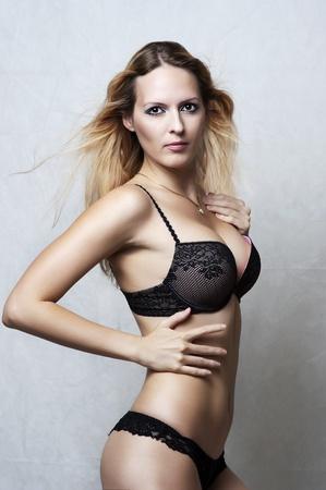 Fashion portrait of sexy fit underwear model. Young woman wearing black lacy bikini Stock Photo - 10906159