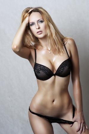 Fashion portrait of sexy fit underwear model. Young woman wearing black lacy bikini Stock Photo - 10906153