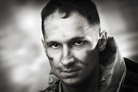 post apocalypse: Portrait of handsome tired sad male soldier, black and white Stock Photo