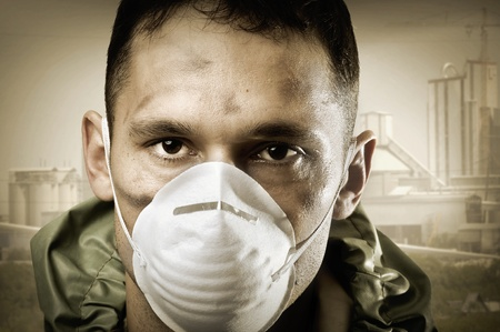 Post apocalypses world halloween concept. Portrair of young Sad man in breathing mask  photo